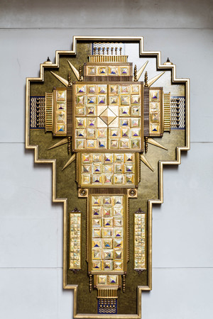christian altar: Cross on wall of church of inlaid gold foil