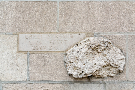 artefacts: Piece from the ancient Great Pyramid in Giza Egypt embedded in a wall in Chicago