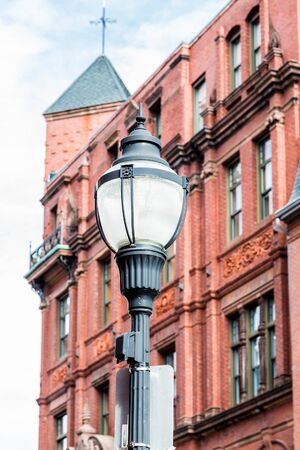 abandoned warehouse: A classic old lamp post in front of an old red brick building