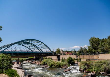 denver parks: The Platte river running under a bridge in Confluence Park in Denver, Colorado