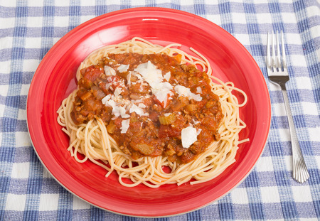 A plate of delicious spaghetti with meat sauce Фото со стока