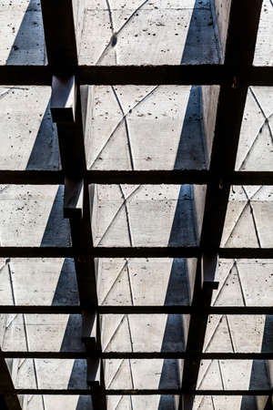 Industrial ceiling of formed concrete and beams Stock Photo