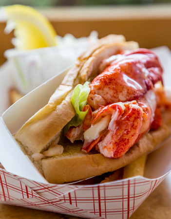 lobster dinner: A traditional New England lobster roll in a cardboard container Stock Photo