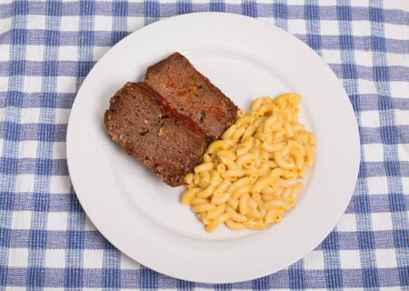 meatloaf: Slices of meatloaf with macaroni and cheese