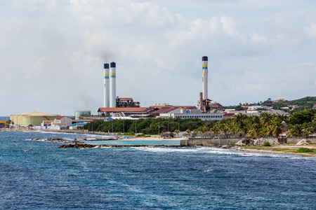 heavy fuel: Heavy Industrial fuel plant on the coast of Curacao Stock Photo