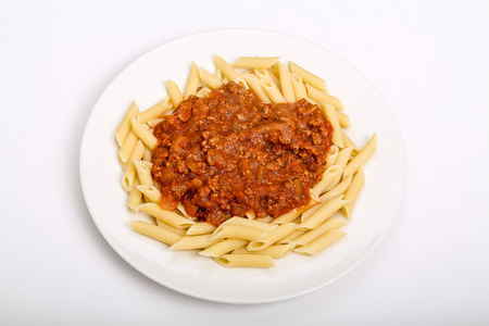 Penne pasta topped with fresh bolognese sauce