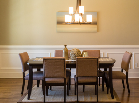 dining table and chairs: A modern dining room table and chairs