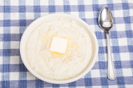 grits: Hot bowl of grits with melting butter