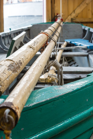green boat: Masts on a green boat in a ship builders shop