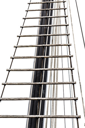 rope ladder: Wood and rope ladder up a tall mast of a sailing ship isolated on white Stock Photo