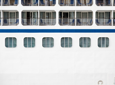 verandas: Windows, verandas and decks on the side of a massive luxury cruise ship