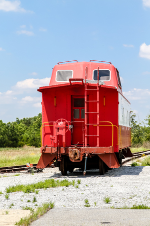 caboose: An old red caboose on a track under blue skies Stock Photo