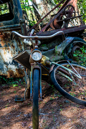 old truck: An old vintage bicycle and a rusty old truck