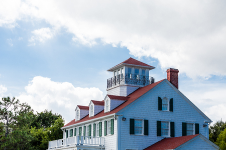 Cliassic white home with red roof, dormers and widows walk photo