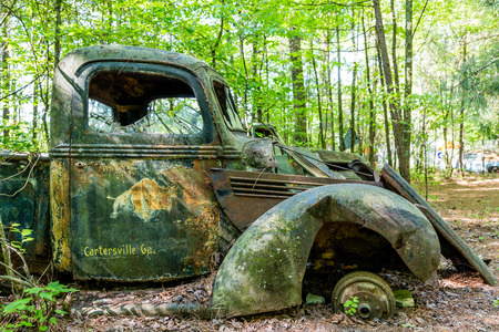 abandoned car: An old abandoned truck in woods near Cartersville, Georgia