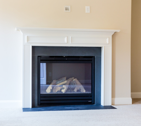 gas fireplace: A gas burning fireplace in a new home