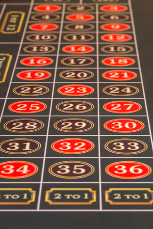 casino table: Number on Green Felt of a Roulette Table