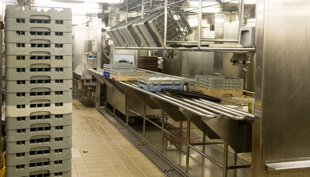 Modern stainless steel dishwashing equipment in a commercial kitchen