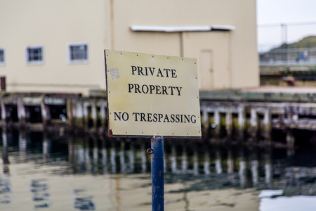 trespassing: Private Property No Trespassing sign in commercial harbor