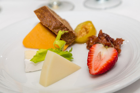 A fruit and cheese plate with brie and strawberry Reklamní fotografie