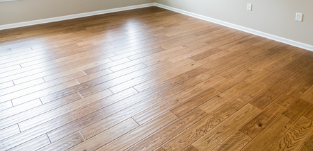 oak wood: A shiny, polished hardwood floor in a new home Stock Photo