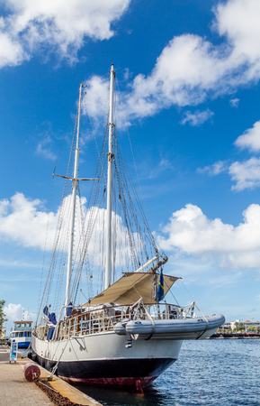 schooner: A schooner docked in colorful Curacao under blue skies