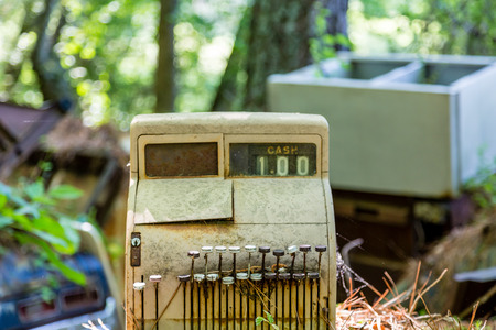 junk yard: An old rusty cash register abandoned in a junk yard Stock Photo