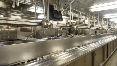 Stainless steel utensils hanging in a commercial kitchen