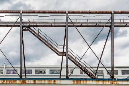 cat walk: An old rusty staircase from a warehouse to a cat walk Stock Photo