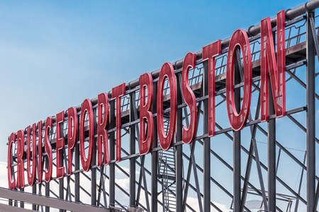 rood teken: Red sign on warehouse over Cruise Port Boston