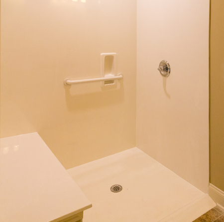 shower stall: A new cultured marble shower with handicap access Stock Photo