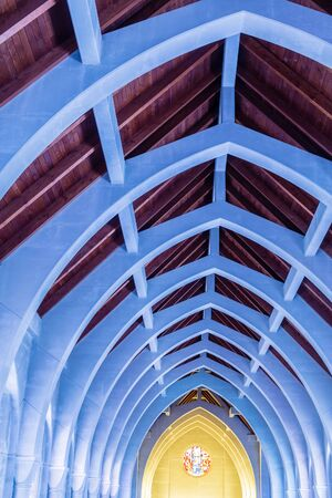 rafters: Natural wood roof and cement arched beams in an old abbey  Stock Photo