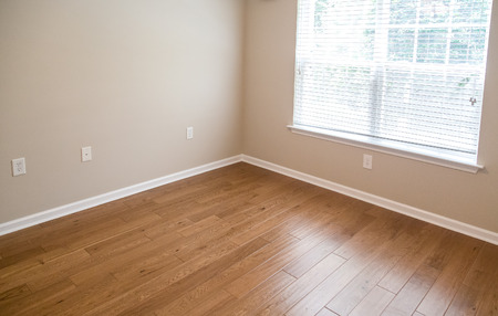 laminate flooring: New Hardwood floor in new home Stock Photo