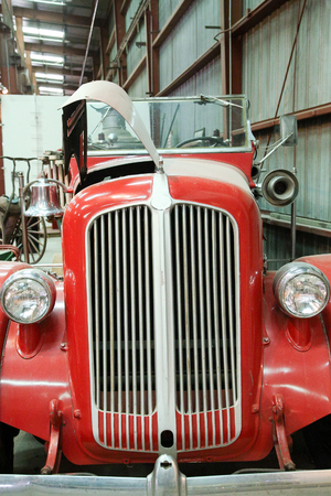 antique fire truck: Front end and chrome grill of an antique fire truck