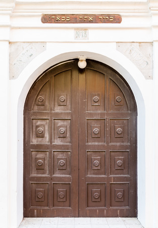 synagogue: An old brown wooden door leading to a Jewish Synagogue Stock Photo