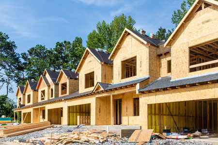 construction sites: New Row House Construction with wood sheathing and asphalt roof Stock Photo