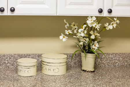 kitchen countertops: A modern ktichen with white wood cabinets and new granite countertop