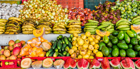Topical market with mangoes, plaintains and coconuts on Curacao