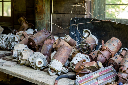 A pile of old distributors in a junkyard