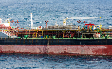 energy channels: Massive frieghter leaving the harbor on Curacao