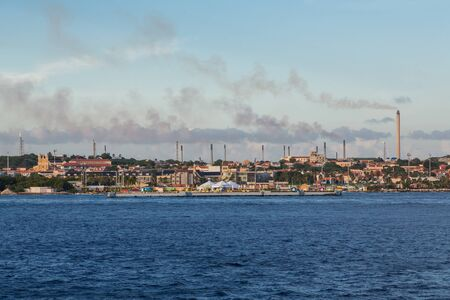 heavy industry: Heavy Industry along the colorful coast of Curacao Stock Photo