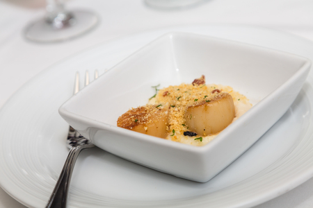 broiled: An appetizer of fresh broiled scallops