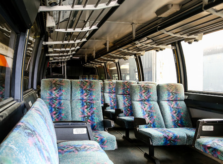 cushioned: Interior of an old city transit bus Stock Photo