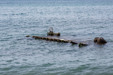 wreckage: Old rusty wreckage in shallow water off the coast of St Kitts