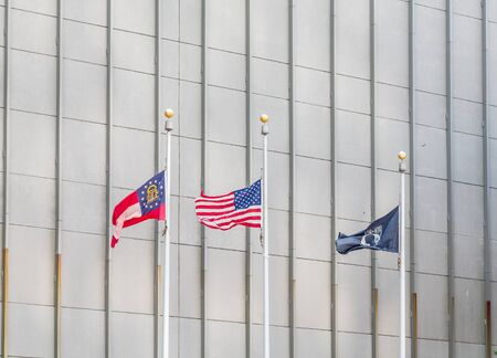 flagpoles: Three flagpoles with American, Georgia and MIAPOW flags