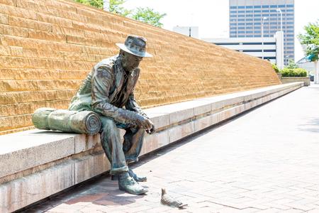 hobo: Bronze statue of a hobo on a bench feeding a pigeon in Atlanta near Underground Atlanta