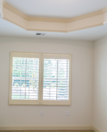 White Plantation Shutters in a new home Stock Photo