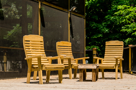 treated board: A treated lumber deck with wood chairs