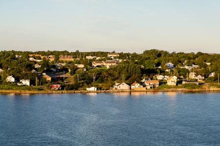 scotia: Homes and boats along the shore of Sydney, Nova Scotia, Canada