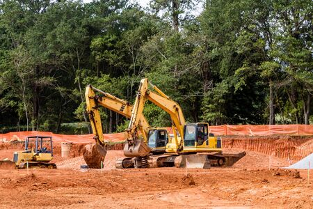dumps: Heavy construction equipment in a new residentail site Stock Photo